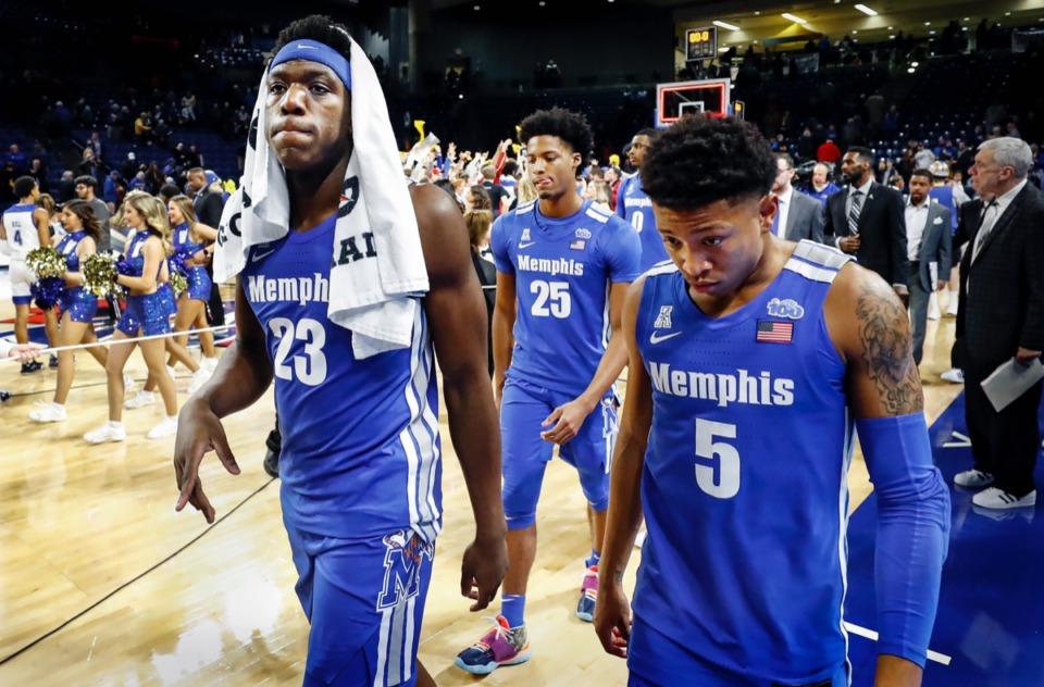 <strong>Memphis teammates (left to right) Malcolm Dandridge, Jayden Hardaway and Boogie Ellis walk off after an 80-40 loss to the Golden Hurricane Wednesday, Jan. 22, 2020, in Tulsa, Oklahoma.</strong> (Mark Weber/Daily Memphian)