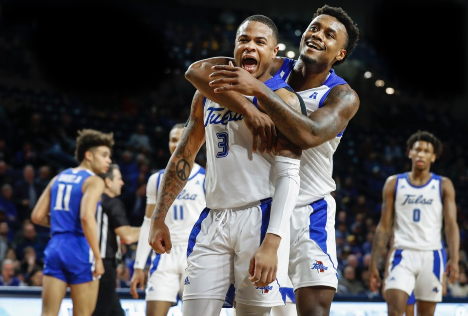 <strong>Tulsa teammates Elijah Joiner (middle) and Martins Igbanu (right) celebrate after a personal foul by Memphis guard Lester Quinones (left) Wednesday, Jan. 22, 2020, in Tulsa, Oklahoma.</strong> (Mark Weber/Daily Memphian)