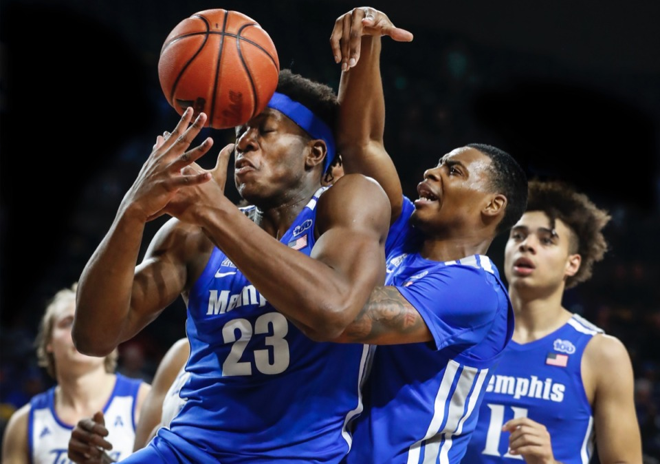 <strong>Memphis forward Malcolm Dandridge (left) loses the ball out of bounds off his head while battling teammate DJ Jeffries (middle) for a rebound as Lester Quinones (right) looks on in the game against the Golden Hurricane Wednesday, Jan. 22, 2020, in Tulsa, Oklahoma.</strong> (Mark Weber/Daily Memphian)