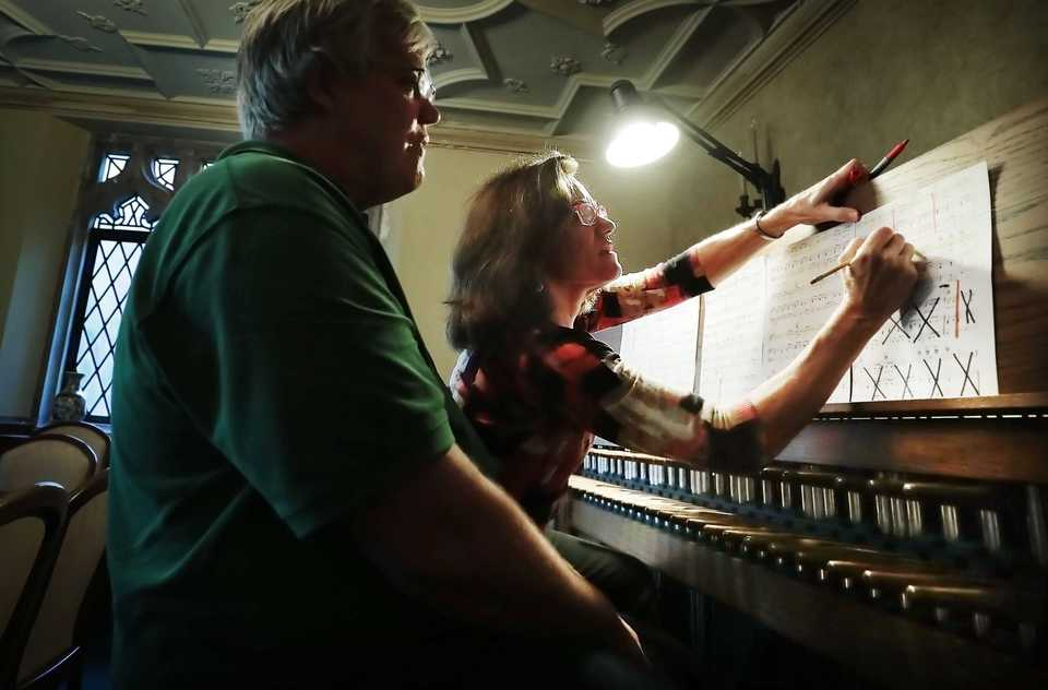 """<p class=""""p1""""><b>Carillonneurs Peggy McClure (right) and David Caudill work to adapt Aretha Franklin songs while rehearsing in the back of Idlewild Presbyterian Church on Nov. 8, 2018, for the fall carillon concert. </b>(Jim Weber/Daily Memphian)"""