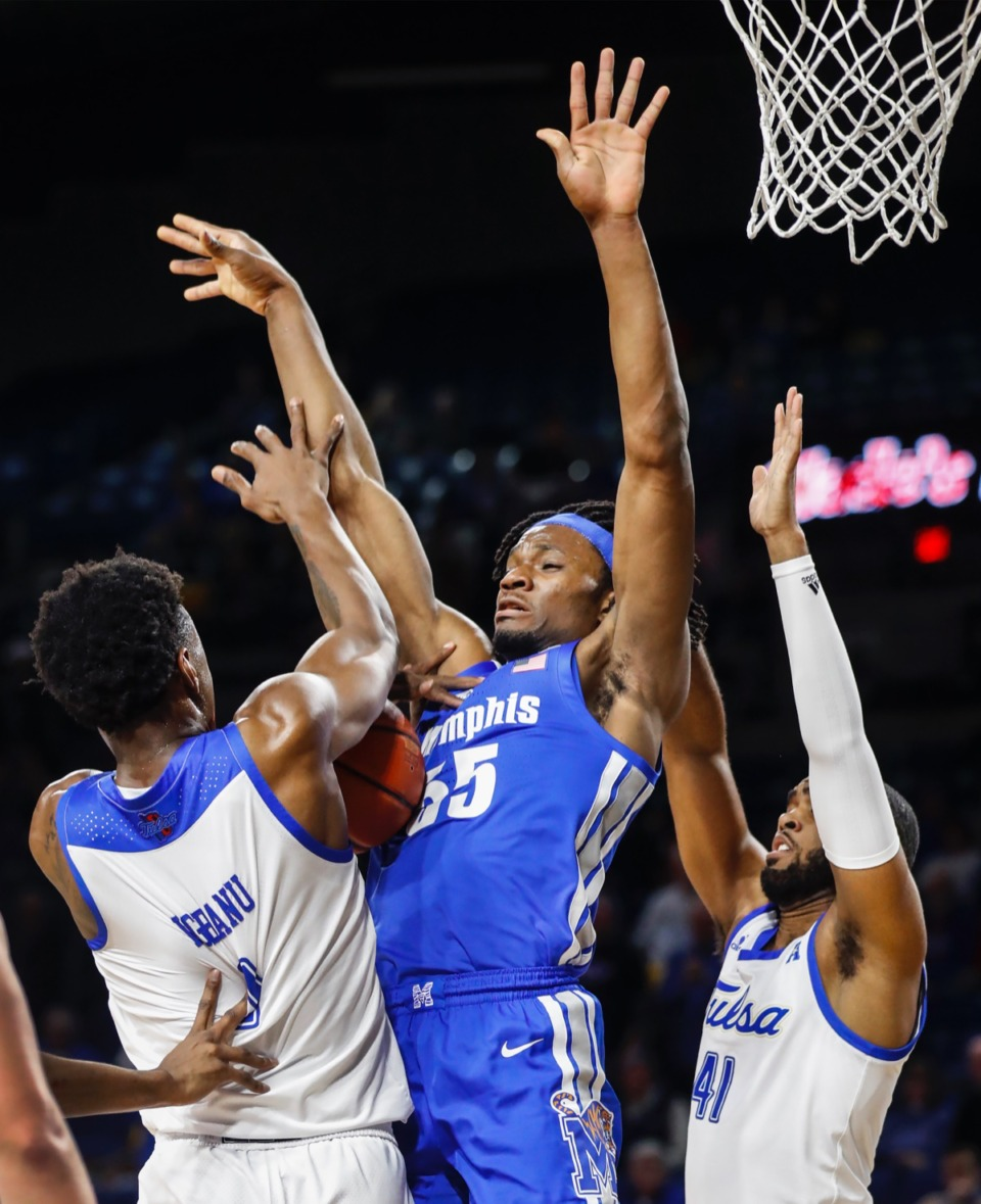 <strong>Memphis forward Precious Achiuwa (middle) loses control of the ball while guarded by Hurricane defenders Brandon Rachal (left) and Jeriah Horne (right) Wednesday, Jan. 22, 2020, in Tulsa, Oklahoma.</strong> (Mark Weber/Daily Memphian)