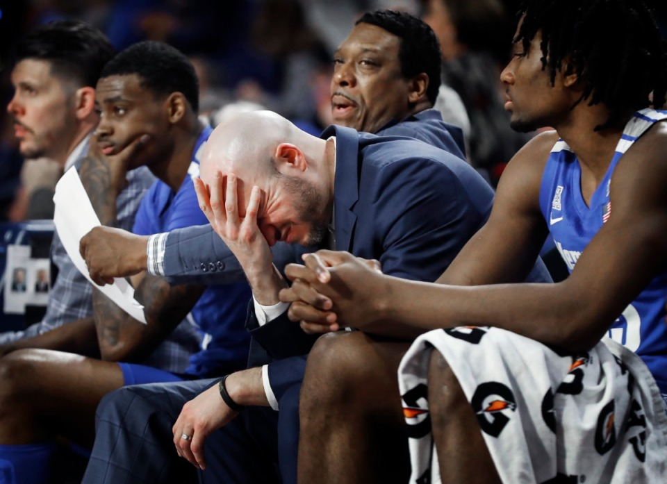 <strong>Memphis assistant coach Cody Toppert (middle) reacts on the bench during the final seconds of an 80-40 loss to Tulsa Wednesday, Jan. 22, 2020.&nbsp;</strong>(Mark Weber/Daily Memphian)