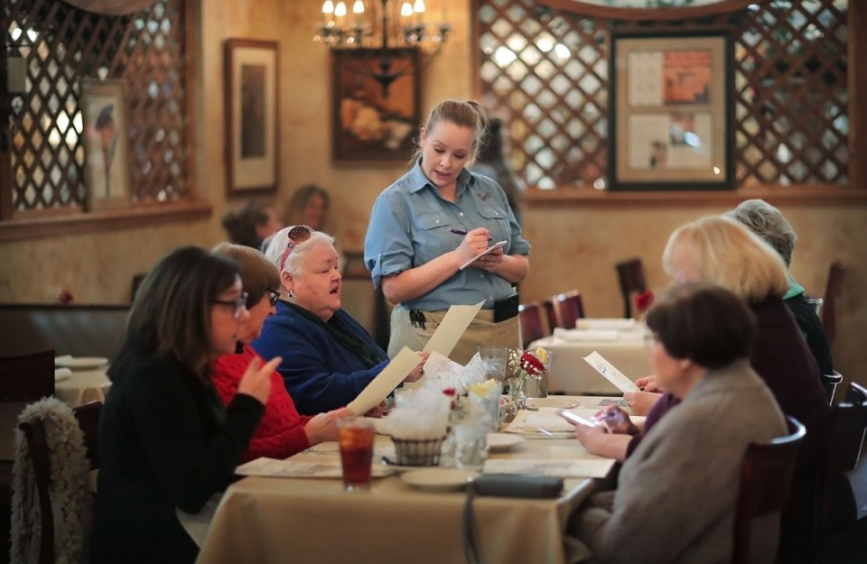 <strong>Franchele Kusmierz takes a round of lunch orders on Jan. 22, 2020, at David Grisanti's Italian restaurant located in the Sheffield Antiques Mall in Collierville.&nbsp;</strong>(Jim Weber/Daily Memphian)
