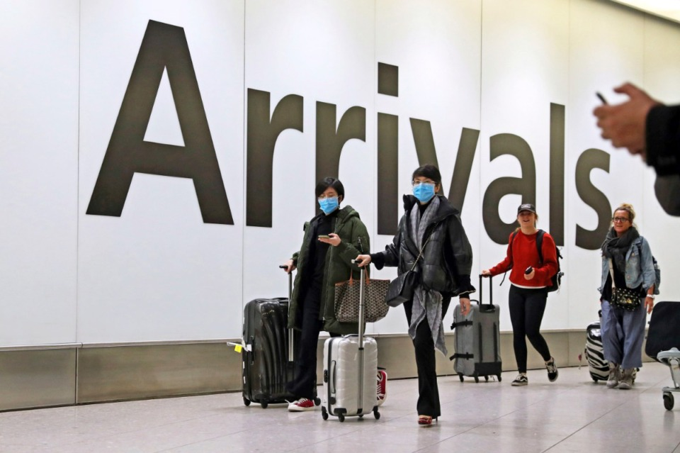 <strong>Passengers pass through Heathrow Terminal 4 in London as the government's Cobra committee is meeting in Downing Street to discuss the threat to the UK from coronavirus. In Tennessee,&nbsp;a student is being kept isolated during preliminary testing for the coronavirus.&nbsp;</strong>(Press Association via AP Images)