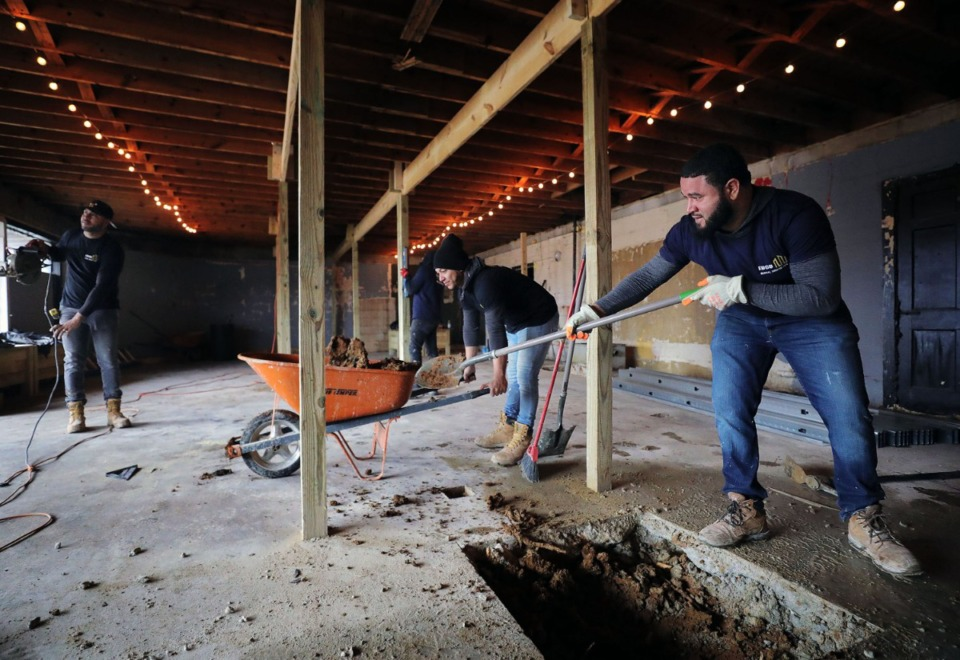 <strong>The Alcy Ball Development Corp. hopes to restore the old Rogers store, which was once a community gathering space.</strong>&nbsp;<strong>Richard De La Rosa (right) and Albert Jimenez (center), with Edco General Construction, clear out the structure at 1672 E. Alcy Road.&nbsp;</strong>(Patrick Lantrip/Daily Memphian)