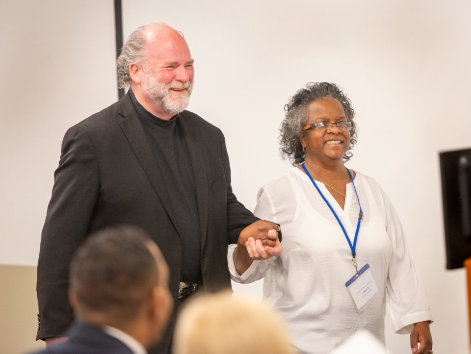 <strong>Debra Salters escorts Juvenile Court Judge Dan Michael to the podium for his State of the Juvenile Court address before law enforcement, colleagues and county officials Friday, January 23, 2020.</strong> (Greg Campbell/Special for The Daily Memphian)