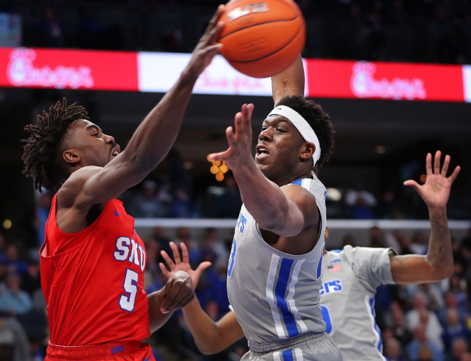 <strong>University of Memphis forward Malcolm Dandridge pressures the Mustangs' Emmanuel Bandoumel on a pass attempt during the Tigers' game on Jan. 25, 2020, against SMU at the FedExForum.</strong> (Jim Weber/Daily Memphian)