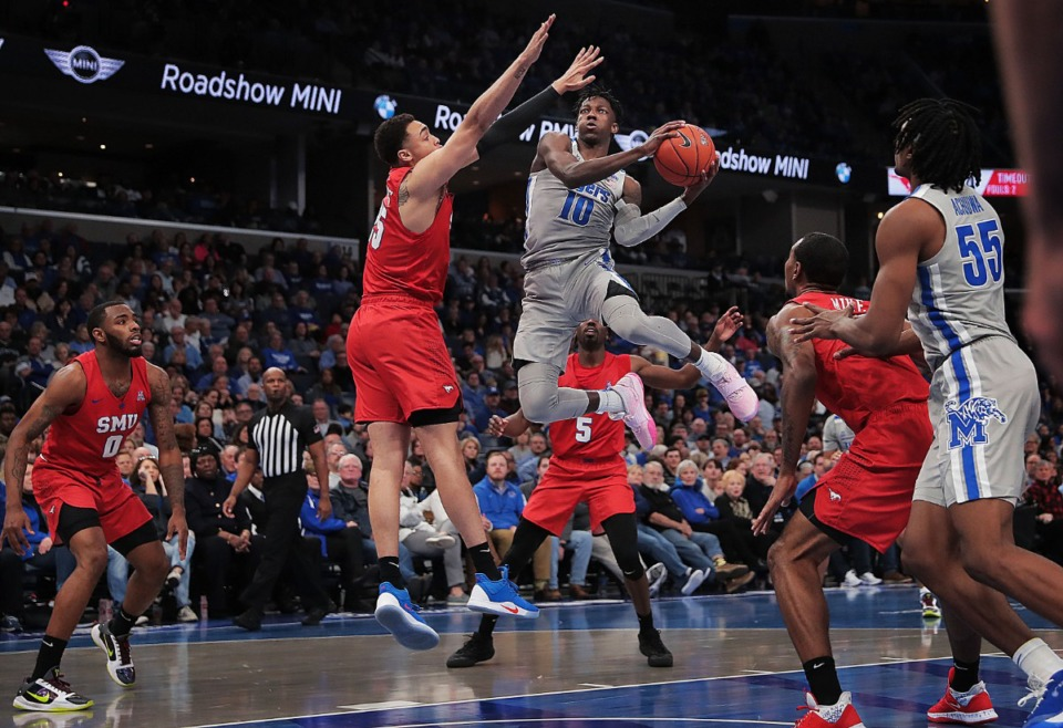 <strong>University of Memphis guard Damion Baugh (10) shoots under pressure by the Mustangs' Ethan Chargois during the Tigers' game on Jan. 25, 2020, against SMU at the FedExForum.</strong> (Jim Weber/Daily Memphian)