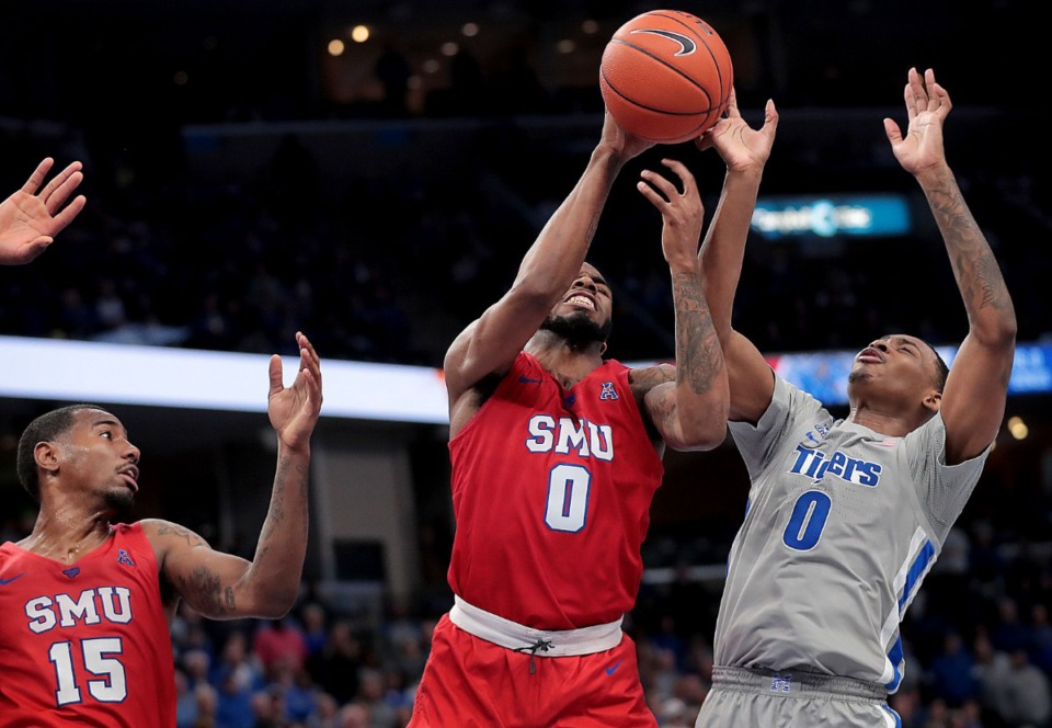 <strong>University of Memphis guard D.J. Jeffries (right) battles for a rebound with the Mustangs' Tyson Jolly (0) during the Tigers' game on Jan. 25, 2020, against SMU at the FedExForum.</strong> (Jim Weber/Daily Memphian)