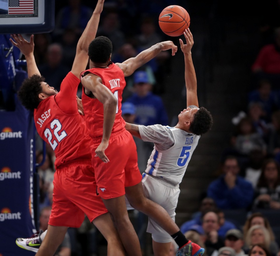 <strong>University of Memphis guard Boogie Ellis (5) shoots under pressure by the Mustangs' Feron Hunt (1) and Isiah Jasey (22) during the Tigers' game on Jan. 25, 2020, against SMU at the FedExForum.</strong> (Jim Weber/Daily Memphian)