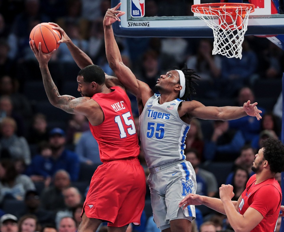 <strong>University of Memphis forward Precious Achiuwa (55) loses a rebound to the Mustangs' Isiah Mike (15) during the Tigers' game on Jan. 25, 2020, against SMU at the FedExForum.</strong> (Jim Weber/Daily Memphian)