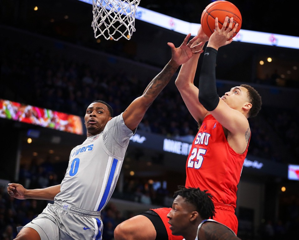 <strong>University of Memphis forward D.J. Jeffries (0) puts pressure on the Mustangs' Ethan Chargois (25) during the Tigers' game on Jan. 25, 2020, against SMU at the FedExForum.</strong> (Jim Weber/Daily Memphian)