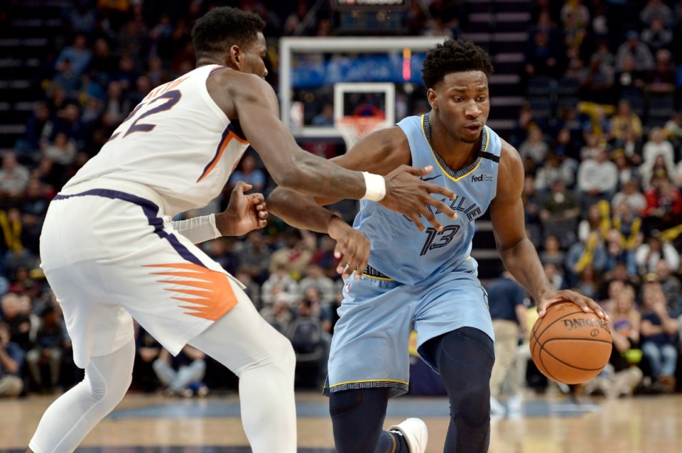 <strong>Memphis Grizzlies forward Brandon Clarke (15) steals the ball between Phoenix Suns forward Mikal Bridges (25) and center Deandre Ayton (22) in the second half of an NBA basketball game Sunday, Jan. 26, 2020, at FedExForum.</strong> (Brandon Dill/AP)