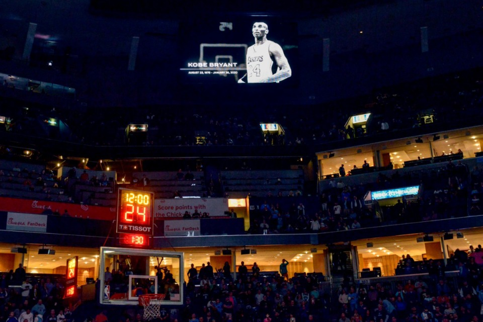 <strong>Players and fans observe a moment of silence for former NBA player Kobe Bryant before a basketball game between the Phoenix Suns and the Memphis Grizzlies, Sunday, Jan. 26, 2020, in Memphis, Tenn. Bryant died in a California helicopter crash Sunday.</strong> (AP Photo/Brandon Dill)