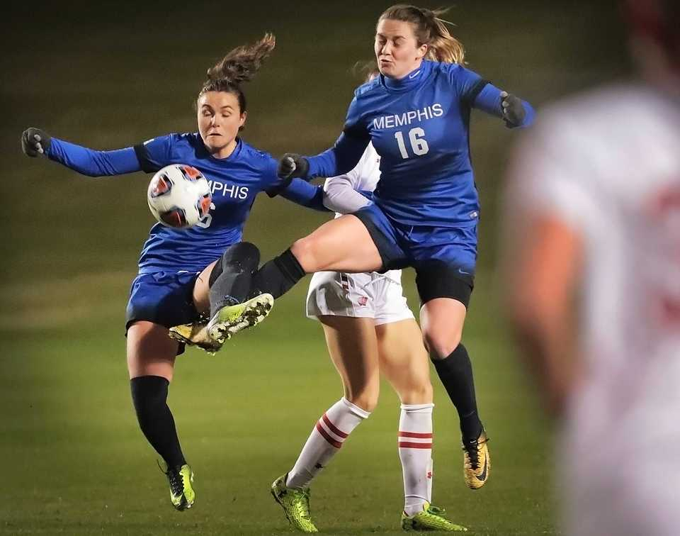 <strong>University of Memphis midfielder Catherine Levasseur (left) and defender Olivia Gauthier block out Wisconsin's Grace Krygier during the Tigers' game against Wisconsin in the first round of the NCAA Women's Soccer tournament at the Mike Rose Soccer Complex on Friday, Nov. 9.</strong> (Jim Weber/Daily Memphian)