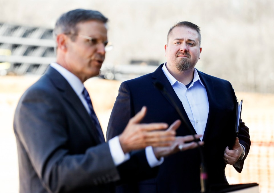 <strong>Amazon Director of Regional Operations Rob Packett (right) listens to Tenn. Gov. Bill Lee speak during a press conference announcing a new Amazon fulfillment center on Jan. 27, 2020, in Raleigh-Frayser.</strong> (Mark Weber/Daily Memphian)