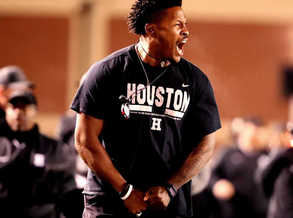 <strong>Houston High School physical trainer Raheem Shabazz shouts as the Mustangs score a touchdown against the Whitehaven Tigers in a playoff game Friday, Nov. 9, at Houston.</strong> (Houston Cofield/Daily Memphian)