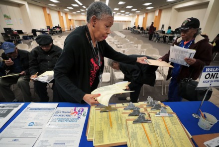 <strong>Volunteer Ruth Taylor (left) helps clients register at the United Way's Free Tax Prep clinic at Southland Mall on Jan 28, 2020. The number of Memphians taking advantage of the free tax service from United Way has been trending upward over the years.</strong> (Jim Weber/Daily Memphian)