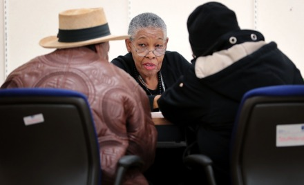<strong>Volunteer Ruth Taylor (center) helps clients register at the United Way's Free Tax Prep clinic at Southland Mall on Jan 28, 2020. The number of Memphians taking advantage of the free tax service from United Way has been trending upward over the years.</strong> (Jim Weber/Daily Memphian)