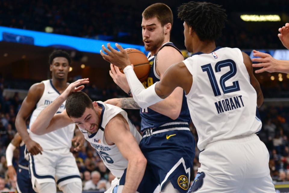 <strong>Denver Nuggets forward Juan Hernangomez, center, struggles to control the ball between Memphis Grizzlies guards John Konchar (46) and Ja Morant (12) Jan. 28, 2020,</strong>&nbsp;<strong>at FedExForum.</strong> (Brandon Dill/AP)