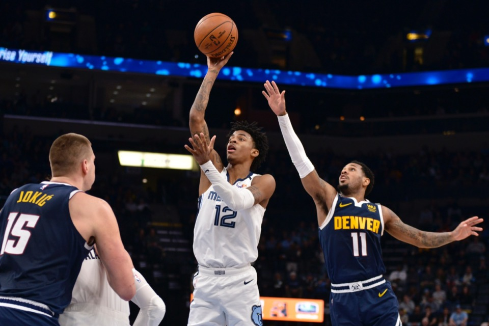 <strong>Memphis Grizzlies guard Ja Morant (12) shoots ahead of Denver Nuggets guard Monte Morris (11) in the second half of an NBA basketball game Tuesday, Jan. 28, 2020, at FedExForum.</strong> (Brandon Dill/AP)