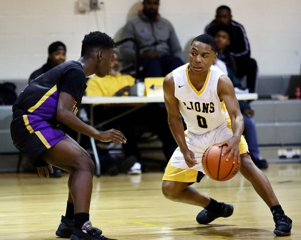 <strong>Memphis Academy of Health Sciences player Robert Mitchell (0) drives to the basket during a home victory against Trezevant High School Jan. 28, 2020.</strong> (Patrick Lantrip/Daily Memphian)