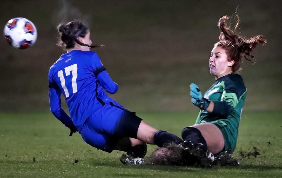 <strong>Wisconsin goalkeeper Jordyn Bloomer knocks away a shot attempt by University of Memphis forward Clarissa Larisey during the Tiger's game against Wisconsin in the first round of the NCAA Women's Soccer tournament at the Mike Rose Soccer Complex on Nov 9, 2018.</strong> (Jim Weber/Daily Memphian)