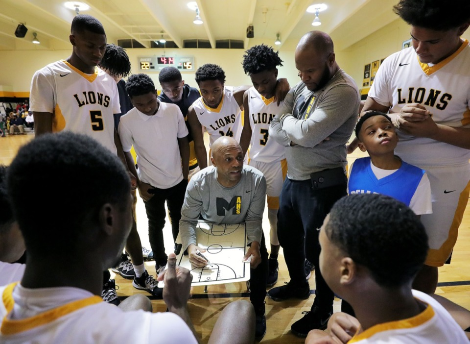 <strong>Memphis Academy of Health Sciences coach Vernard Watkins draws up play during a home victory against Trezevant High School Jan. 28, 2020.</strong> (Patrick Lantrip/Daily Memphian)