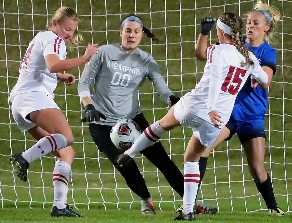 <strong>University of Memphis goalkeeper Elizabeth Moberg moves to block a shot by Wisconsin's Dani Rhodes during the Tiger's game against Wisconsin in the first round of the NCAA Women's Soccer tournament at the Mike Rose Soccer Complex on Nov 9, 2018.</strong> (Jim Weber/Daily Memphian)