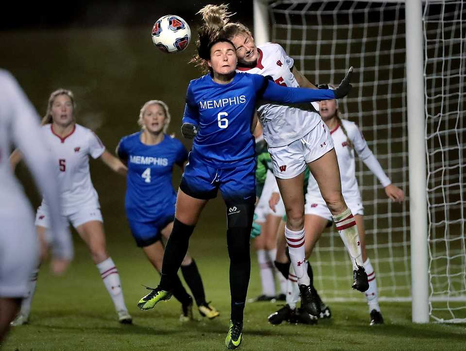 <strong>University of Memphis midfielder Catherine Levasseur (6) goes head-to-head with Wisconsin's Cameron Murtha on a corner kick during the Tiger's game against Wisconsin in the first round of the NCAA Women's Soccer tournament at the Mike Rose Soccer Complex on Nov 9, 2018.</strong> (Jim Weber/Daily Memphian)