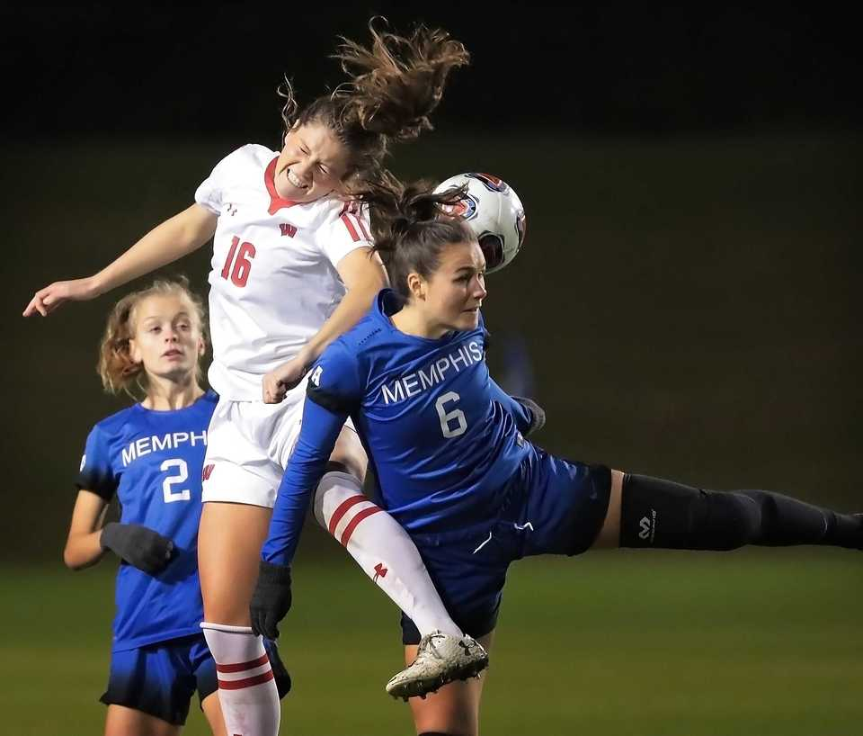 <strong>University of Memphis midfielder Catherine Levasseur (6) goes head-to-head with Wisconsin's Alexis Tye (16) during the Tiger's game against Wisconsin in the first round of the NCAA Women's Soccer tournament at the Mike Rose Soccer Complex on Nov 9, 2018.</strong> (Jim Weber/Daily Memphian)