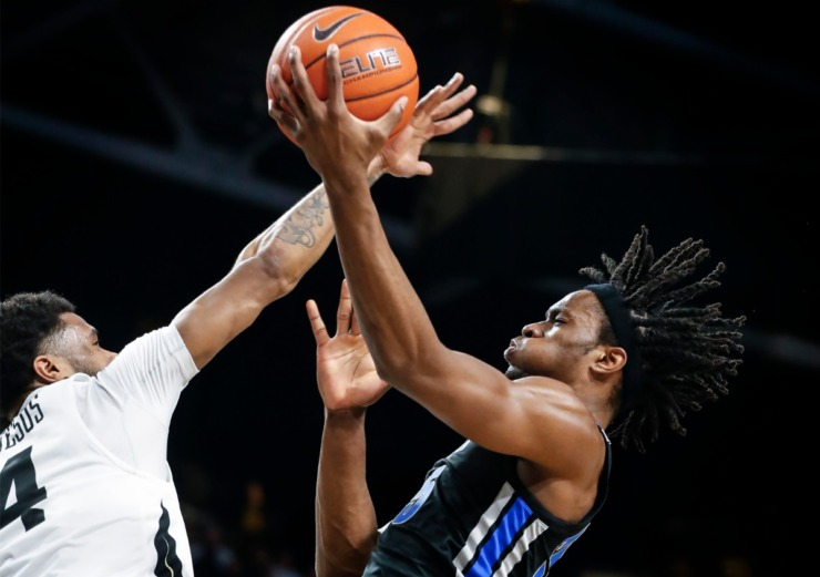 <strong>University of Memphis forward Precious Achiuwa (right) drives for a layup in front of UCF defender Ceasar DeJesus (left) during action on Jan. 29, 2020, in Orlando.</strong> (Mark Weber/Daily Memphian)