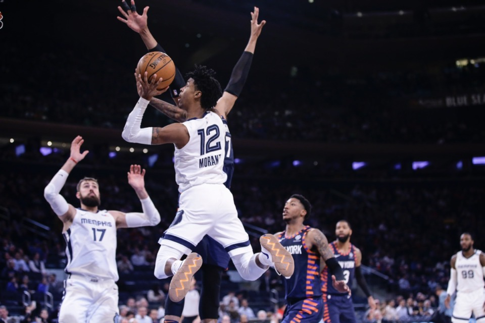 <strong>Memphis Grizzlies' Ja Morant (12) drives past New York Knicks' Taj Gibson (67) an. 29, 2020, in New York. The Grizzlies won 127-106.</strong> (Frank Franklin II/AP)