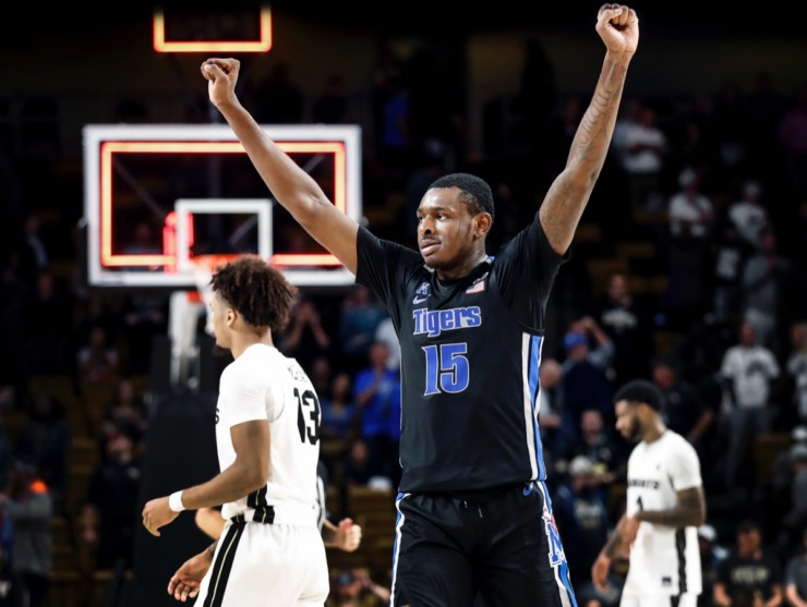 <strong>Memphis forward Lance Thomas (middle) celebrates a 59-57 victory over UCF on Wednesday, Jan. 29, 2020, in Orlando.</strong> (Mark Weber/Daily Memphian)