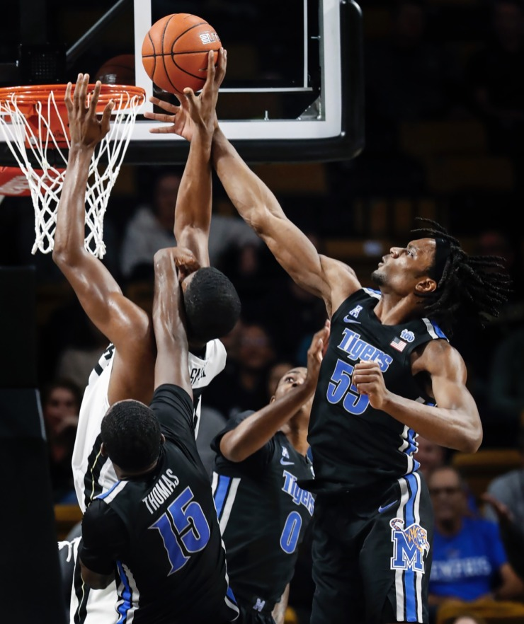 <strong>Memphis defender Precious Achiuwa (right) blocks the shot of UCF forward Collin Smith (middle) as teammate Lance Thomas (bottom) helps defend on the play during action on Wednesday, Jan. 29, 2020, in Orlando.</strong> (Mark Weber/Daily Memphian)