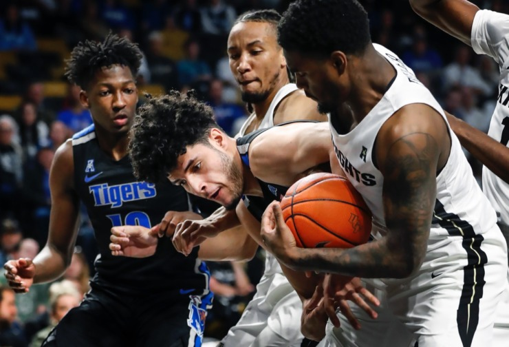<strong>Memphis forward Isaiah Maurice (middle) has a rebound stripped away by UCF defender Dre Fuller Jr. (right) during action on Wednesday, Jan. 29, 2020, in Orlando.</strong> (Mark Weber/Daily Memphian)