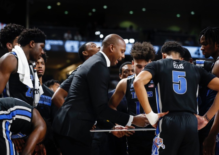 <strong>Memphis head coach Penny Hardaway (middle) directs his team during a timeout against UCF on Wednesday, Jan. 29, 2020, in Orlando.</strong> (Mark Weber/Daily Memphian)