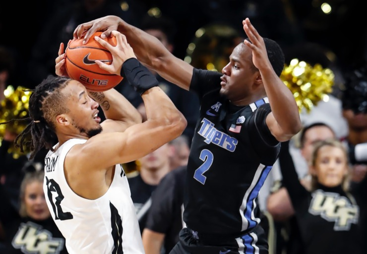 <strong>Memphis defender Alex Lomax (right) applies pressure to UCF guard Dazon Ingram (left) during action on Wednesday, Jan. 29, 2020, in Orlando.</strong> (Mark Weber/Daily Memphian)