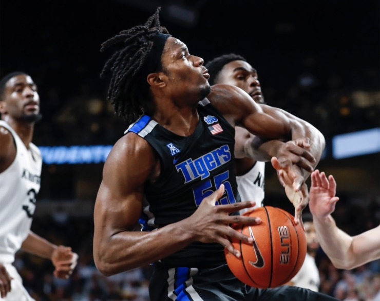 <strong>Memphis forward Precious Achiuwa (left) drives the lane against the UCF defense during action on Wednesday, Jan. 29, 2020, in Orlando.</strong> (Mark Weber/Daily Memphian)
