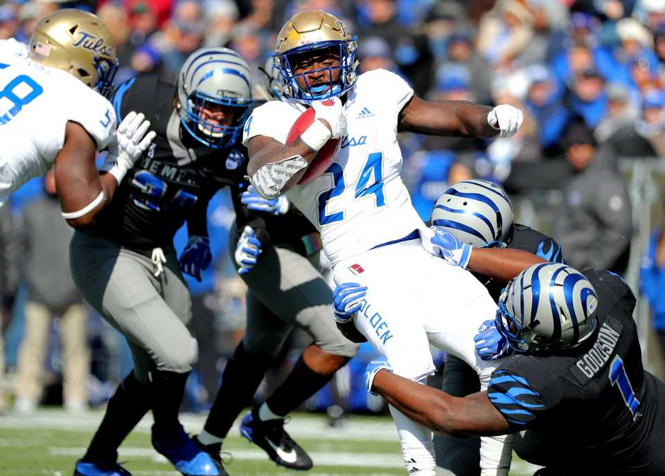 <strong>Memphis Tigers defensive lineman O'Bryan Goodson (1) tackles Tulsa running back Corey Taylor II (24) for a loss on the play. The Tigers won 47-21.</strong> (Houston Cofield/Daily Memphian)