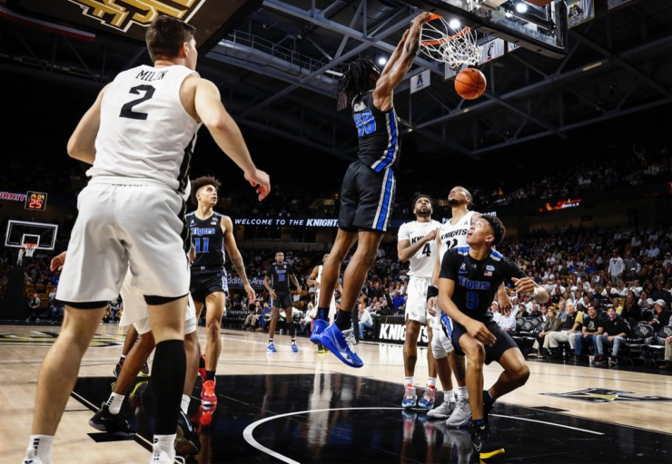 <strong>Memphis forward Precious Achiuwa (middle) goes up for a dunk over the UCF defense during action on Wednesday, Jan. 29, 2020, in Orlando.</strong> (Mark Weber/Daily Memphian)