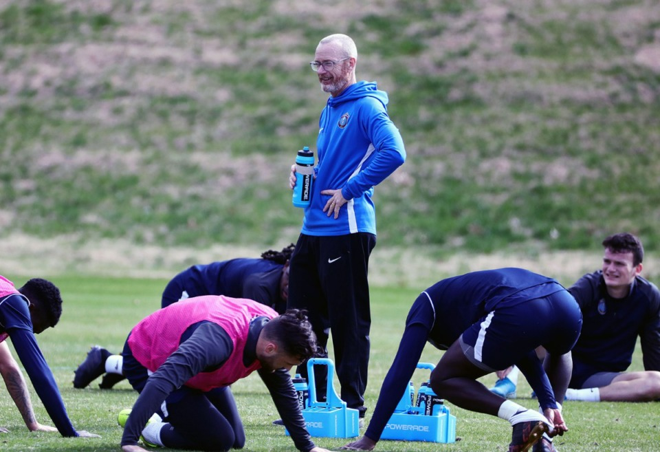 <strong>Head coach Tim Mulqueen laughs with his players after a Jan., 29, 2020 preseason practice at Mike Rose Soccer Complex.</strong> (Patrick Lantrip/Daily Memphian)