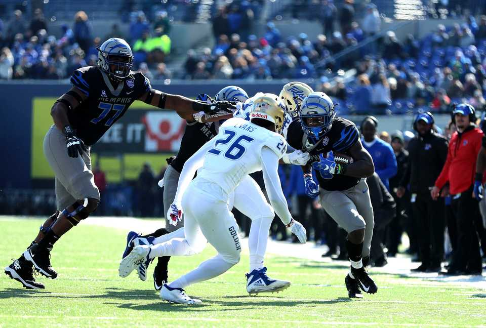 <strong>Memphis Tigers running back Patrick Taylor Jr. (6) weaves through Tulsa defenders as he runs for a long gain in the game against the Golden Hurricanes on Saturday, Nov. 10, 2018.</strong> (Houston Cofield/Daily Memphian)