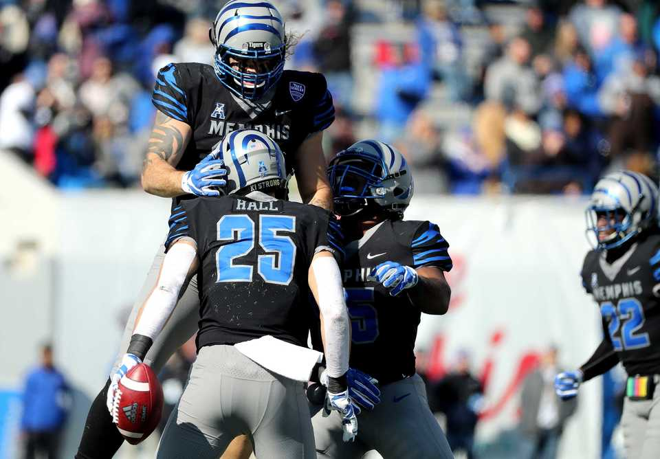 <strong>Memphis Tigers outside linebacker Austin Hall (25) celebrates with defensive lineman Jonathan Wilson (38) after Hall recovered a fumble in a game against Tulsa on Saturday, Nov. 9, 2018. </strong>(Houston Cofield/Daily Memphian)