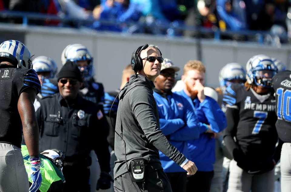 <strong>Memphis Tigers head football coach Mike Norvell grins after watching the replay of a Tigers touchdown during a game against Tulsa on Saturday, Nov. 10, 2018.</strong> (Houston Cofield/Daily Memphian)