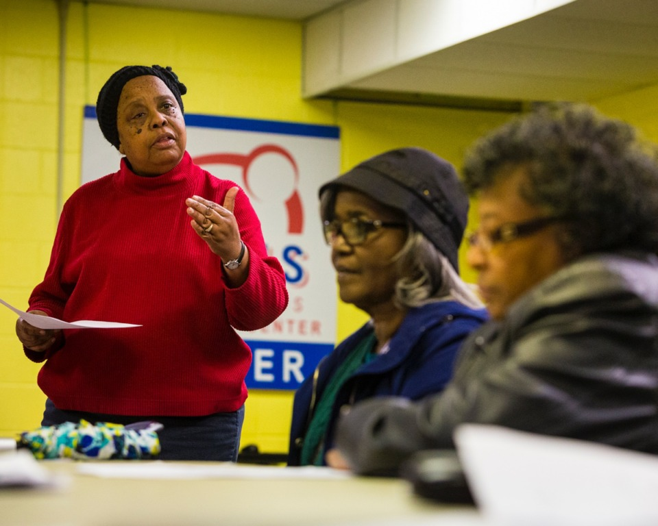 <strong>Regina Dowell (left) speaks with Carrie Wright (center) and Pearly Richardson at the Frayser PTSA Meeting in the Ed Rice Community Center on January 23, 2020.</strong> (Ziggy Mack/Daily Memphian)
