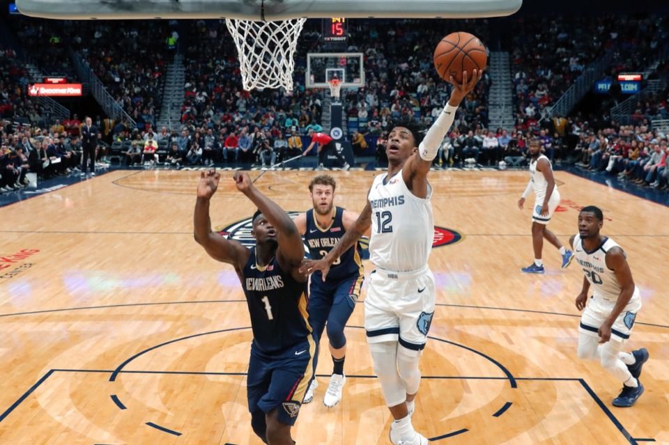 <strong>Memphis Grizzlies guard Ja Morant (12) goes to the basket against New Orleans Pelicans forward Zion Williamson (1) during the first half of an NBA basketball game in New Orleans, Friday, Jan. 31, 2020.</strong> (Gerald Herbert/AP)