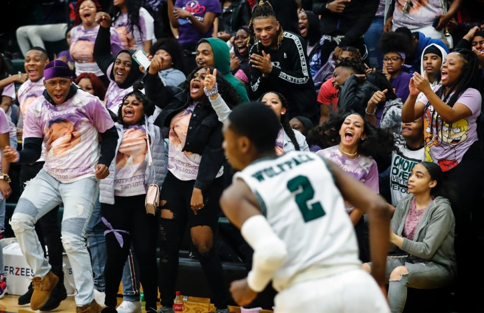 <strong>Cordova students celebrate after Justin Borders, 2, scores against Arlington Jan. 31, 2020.</strong> (Mark Weber/Daily Memphian)