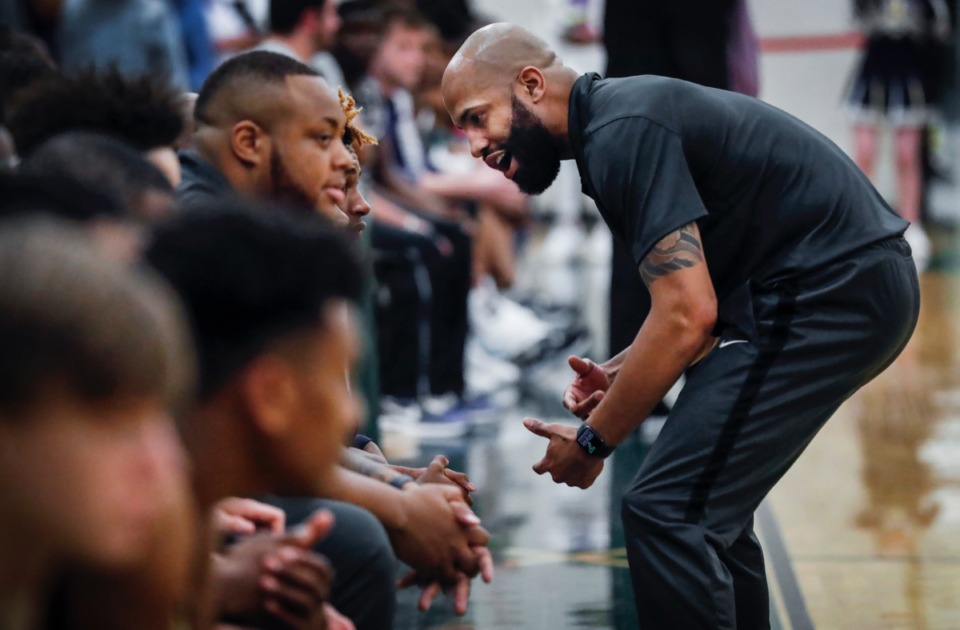 <strong>Arlington head coach Maurice Miller (right) pumps up his team in the game against Cordova on Friday, Jan. 31, 2020.</strong> (Mark Weber/Daily Memphian)