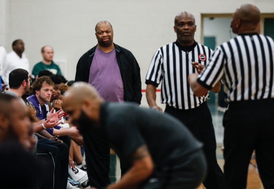 <strong>Cordova head coach Terrance Scales (middle top) reacts to an official's call in the game against Arlington on Friday, Jan. 31, 2020.</strong> (Mark Weber/Daily Memphian)